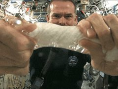 Wringing out a washcloth in space
