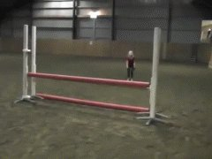10 years girl jumps hurdles on four legs