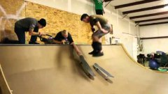 Skateboarder Backflips From One Board To Another