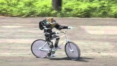 Mini Robot Rides Bicycle