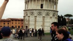 High-Fiving People At The Leaning Tower Of Pisa