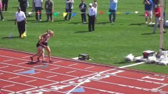 Runner carries fallen competitor to the finish line