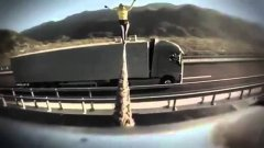 Tightrope walking between two moving Volvo trucks stunt