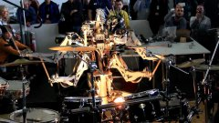 4 armed mohawked robot playing the drums