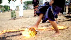 Flaming football: indonesian students play football with fiery coconut