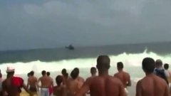 Helicopter crashes into beach