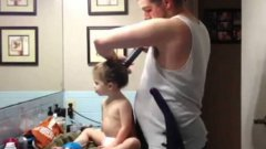 Dad uses vacuum to give daughter perfect ponytail