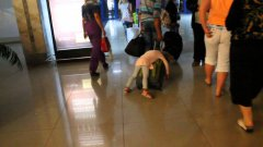 Russian girl sleeps on luggage as dad walks through airport