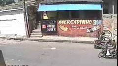 Brazilian convenience store robber is literally thrown out window
