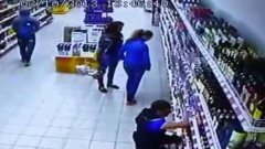 Alcohol shelf collapses in front of two girls shopping for drink