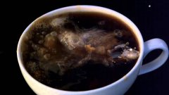 Creamer Poured Into Coffee In Super Slow Motion
