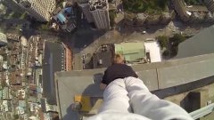 Daredevil Performs Handstand On Edge Of Building