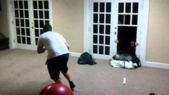 Kid Breaks Through Door Pushed By Exercise Ball
