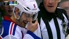 Puck gets wedged in defenceman's mask