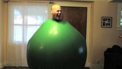 Guy Climbs Inside A Giant Green Balloon