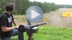 Russian Guy Shoots Rocket Launcher At Barrel Of Gas