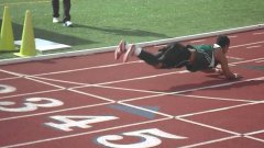 Track Runner Falls, Turn Fail Into Worm Dance