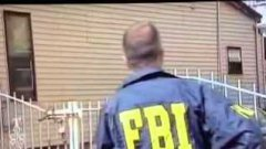 FBI agent jumps open fence